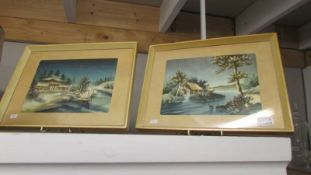 A pair of framed and glazed Chinese pictures.