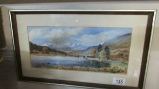 A framed and glazed watercolour rural scene signed S R Knowles.