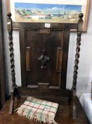 A carved wood fire screen with barley twist side columns