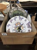 A box of assorted plates, clocks etc.