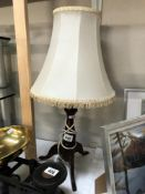A table lamp on tripod base