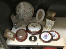 3 clocks & a quantity of photo frames etc.