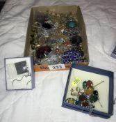 A mixed lot of pendants & necklaces etc.
