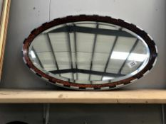 An Edwardian walnut framed bevel edge mirror with blue & silver decoration ****Condition