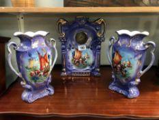 An Edwardian pottery clock set