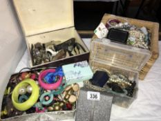 A large selection of costume jewellery including watches (4 boxes)