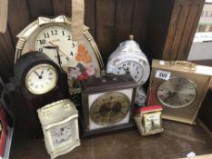 7 assorted clocks.