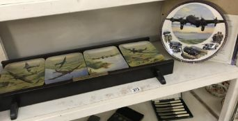 The Battle of Britain memorial flight on 4 Commemorative plates on wall stand,