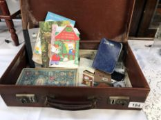 A small vintage leather suitcase & contents