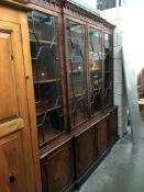 A mahogany 4 door cabinet