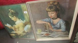 A pair of framed and glazed prints of females.