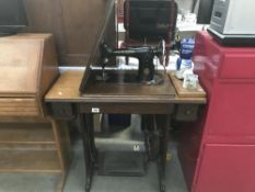 A Singer Treadle sewing machine.