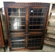 An oak lead glazed bookcase