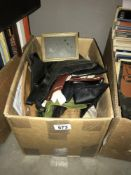 A box containing old gloves, purses etc.