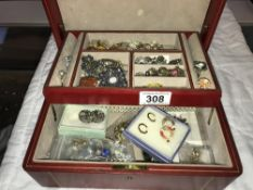 A jewellery box containing earrings & rings etc.