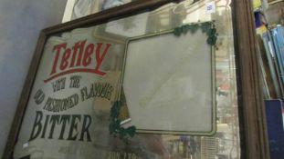 A large framed Tetley Bitter advertising mirror.