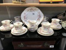 A 21 piece Paragon 'Victoriana Rose' tea set