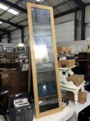 A pine freestanding mirror.