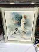 A signed print of a female & dog,
