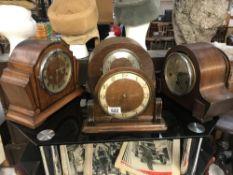 4 mantel clocks.