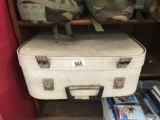 A suitcase containing old dolls.