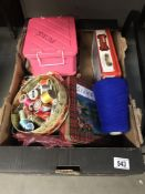 A box of needlework items, cottons etc.