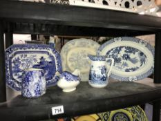A shelf of blue and white china