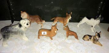 7 dog figures including Corgi & Spaniel etc.