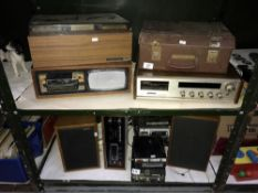 2 shelves of tape players,