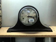 An Edwardian oak mantle clock