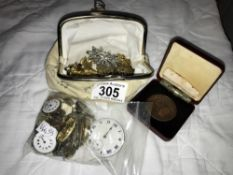A purse containing costume jewellery,
