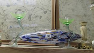 An end of day glass fish and a pair of glass candlesticks.