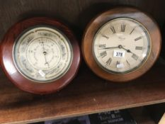 2 wooden framed battery operated wall clocks