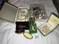 A quantity of costume jewellery including pearls, pill boxes & badge etc.