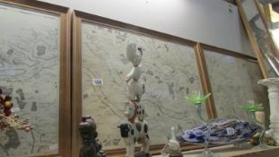 4 framed and glazed maps.