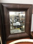 A large leather surround mirror