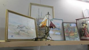 4 framed and glazed nautical themed prints.