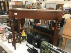 A mahogany side table.