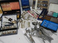 A mixed lot of cutlery including boxed sets, sugar nips etc.