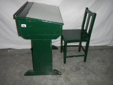 A green painted pine school desk with chair in need of restoration/stripping.
