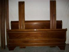 A French Louis Baton solid mahogany bedstead, 6 foot wide and complete.