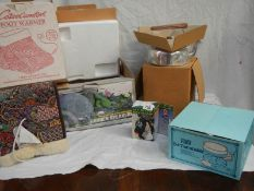 A mixed lot of boxed items including new footwarmer, new kettle.