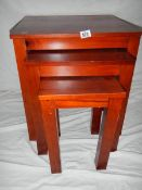 A nest of 3 mahogany tables in good condition.