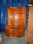A pair of teak corner cupboard/shelf units, the small having lighting, 1 x H 200 cm, W 100 cm,