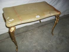 A French style marble topped table on gilded legs, 80 x 38 x 40 cm (marking on top is a seam).