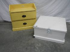 A 2 drawer pine shelf unit in yellow and a pine chest in white.