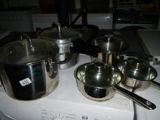 A quality 4 pan stainless steel set with lids and an aluminium pressure cooker.