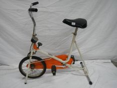A mid to late 20th century exercise bike.