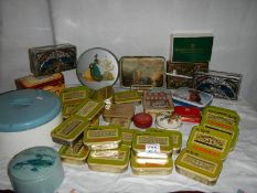 A good mixed lot of old tins including round blue musical powder tin.