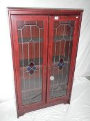 A rosewood veneer leaded glass 3 shelf cabinet, 228 cm high, 30 cm deep and 77 cm wide.